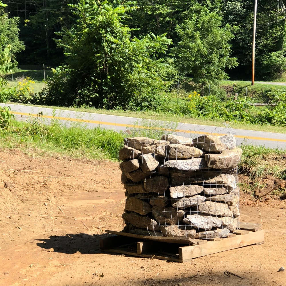 pallet of rocks for ditch drainage