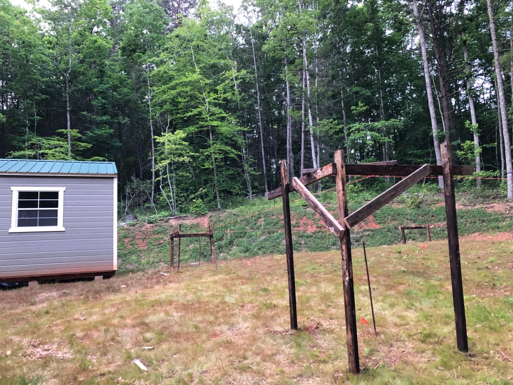 Wooden scaffolding and string for laying out yurt deck.