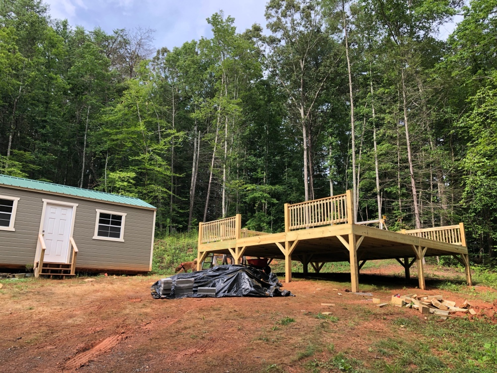 Yurt deck with railing sections installed